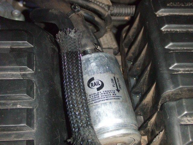 กรองแก๊สยี่ห้อนี้ครับ ด้านบนไม่เห็นสิ่งผิดปกติครับ